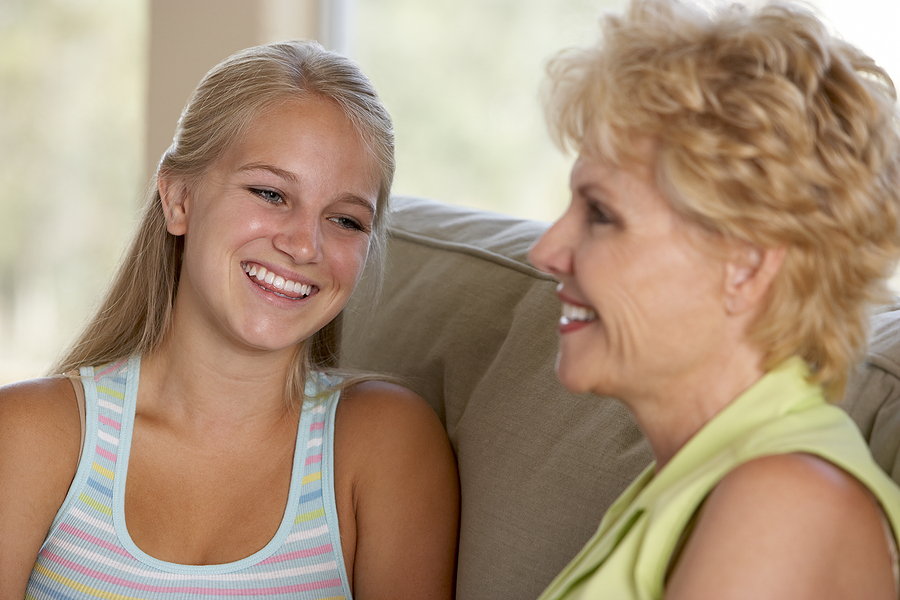 mother-and-teenage daughter-talking-happy